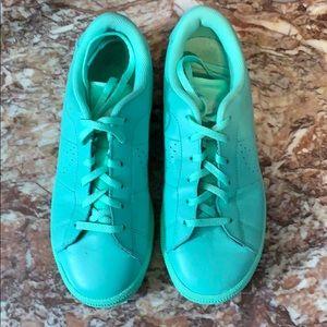 Nike sea foam green sneakers.